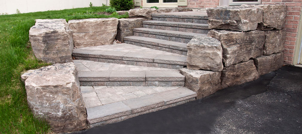 Enigma work - natural rock retaining wall and + interlock steps